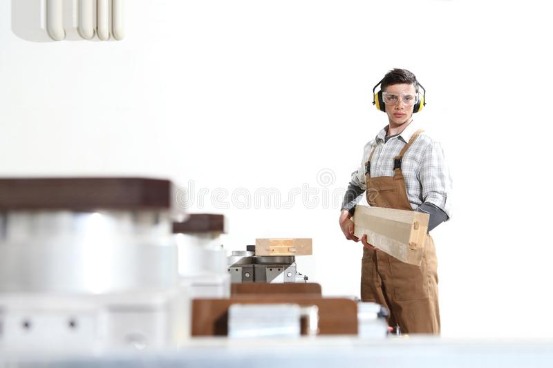 Carpenter man works with wooden planks in the joinery, with computer numerical control center, cnc machine,  isolated on a white royalty free stock photos