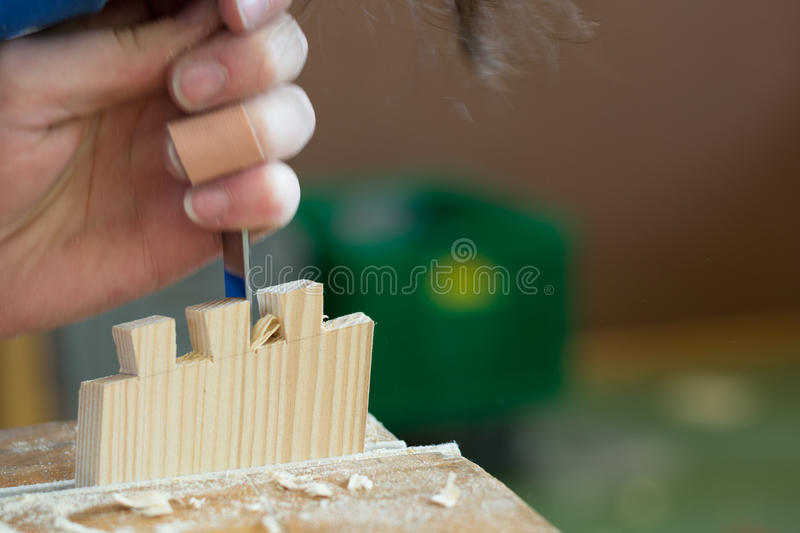 Carpenter manufactures Woodworking. Carpenter makes with wood pieces a dovetailed stock photography