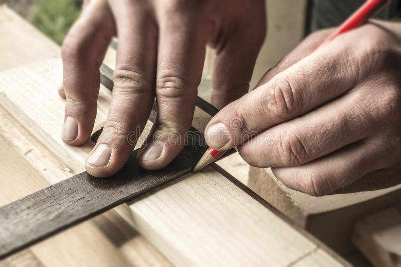 woodworker and red pencil stock image