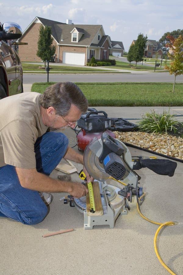 Carpenter measuring stock photos