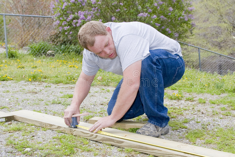 Carpenter measuring board stock photos