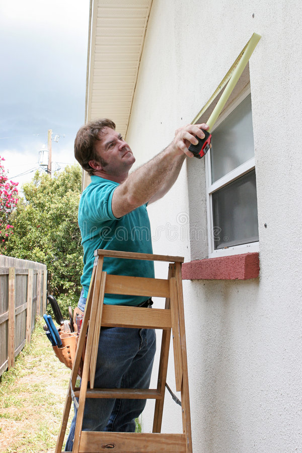 Carpenter Measuring Windows royalty free stock photo