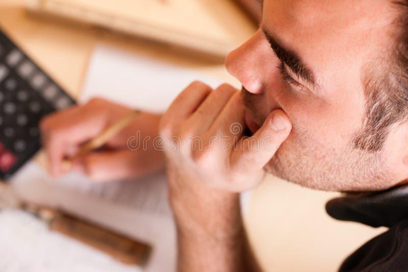 Carpenter planning his work stock image