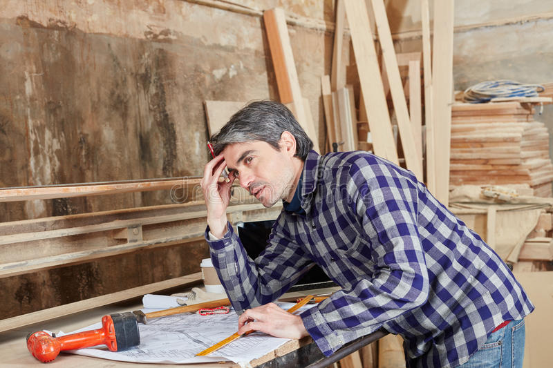 Carpenter planning and thinking about problem royalty free stock images
