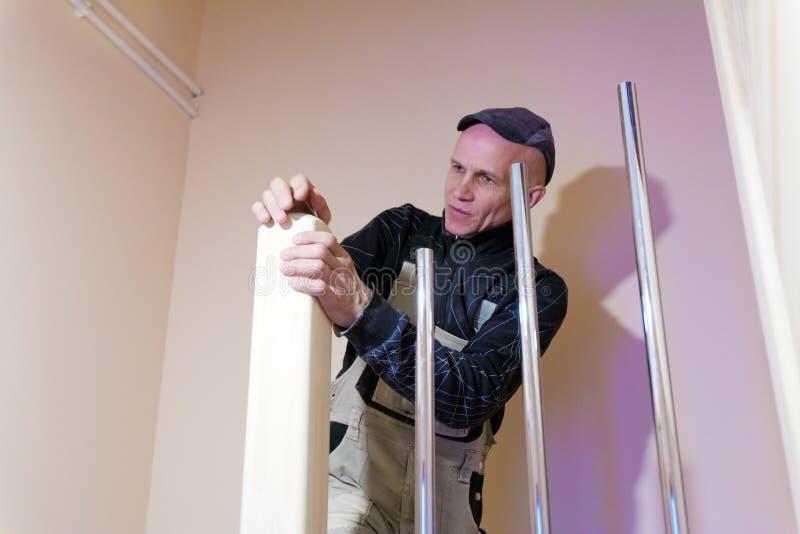 Carpenter Polishing Modern Ladder with Sandpaper royalty free stock photos