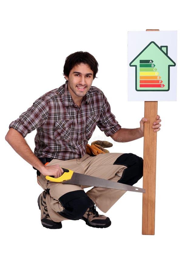 Carpenter promoting energy savings. A carpenter promoting energy savings royalty free stock image