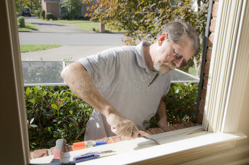 Carpenter repairing window frame royalty free stock images