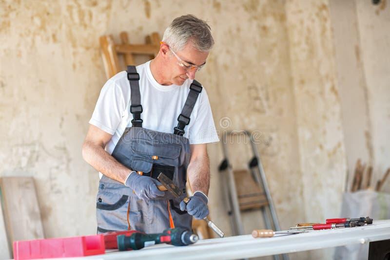 Carpenter restores old door stock images