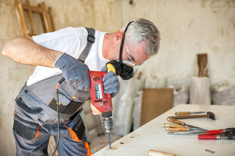 Carpenter restores old door stock photography