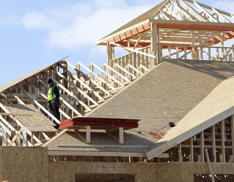 Carpenter on the roof. Carpenter on a roof of a new constructon complex royalty free stock photography
