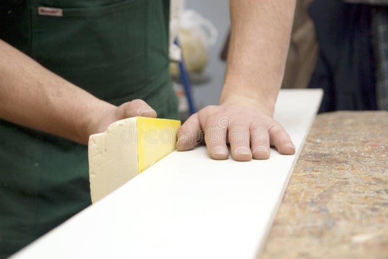 Carpenter sanding wood royalty free stock photos