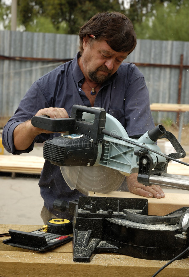 Carpenter and saw stock photos