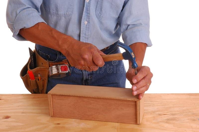 Carpenter setting nail