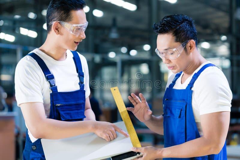Carpenter team in Asian wood workshop royalty free stock image