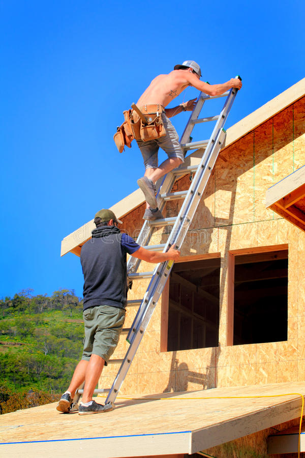 Free Carpenter Teamwork Stock Photography - 58233792
