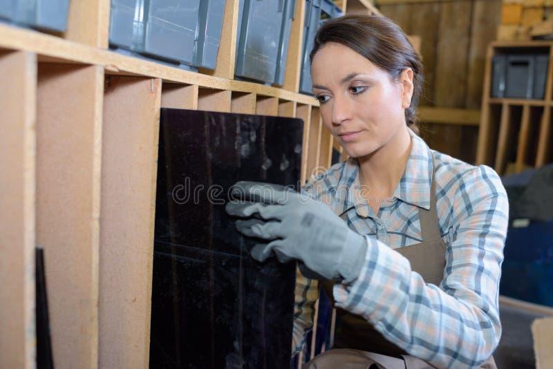 Carpenter testing wood plank evenness stock photos