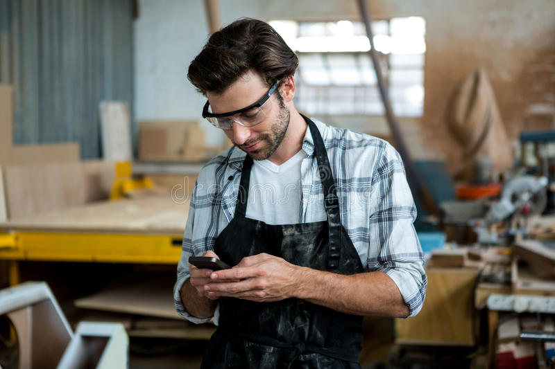 Carpenter texting someone stock photography