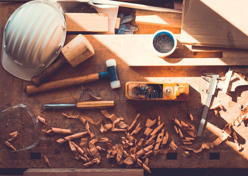 Carpenter tools on wood table background, carpenter tools in pine wood table, Woodworking tools. Carpenter tools,hammer,meter,chisel and shavings over wood table stock image