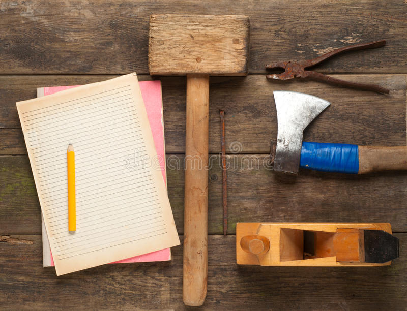 Carpenter tools in pine wood table. Close up stock photography