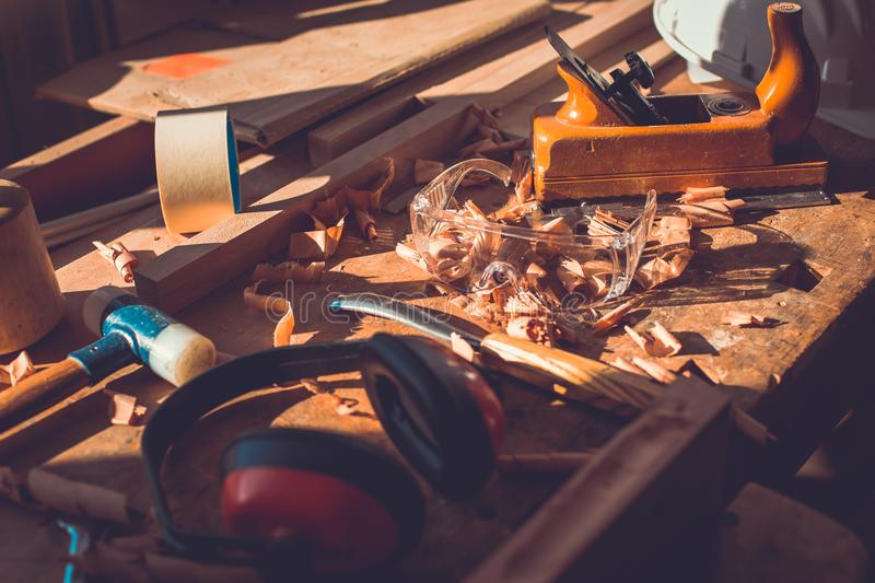 Carpenter tools on wood table background, carpenter tools in pine wood table, Woodworking tools royalty free stock image