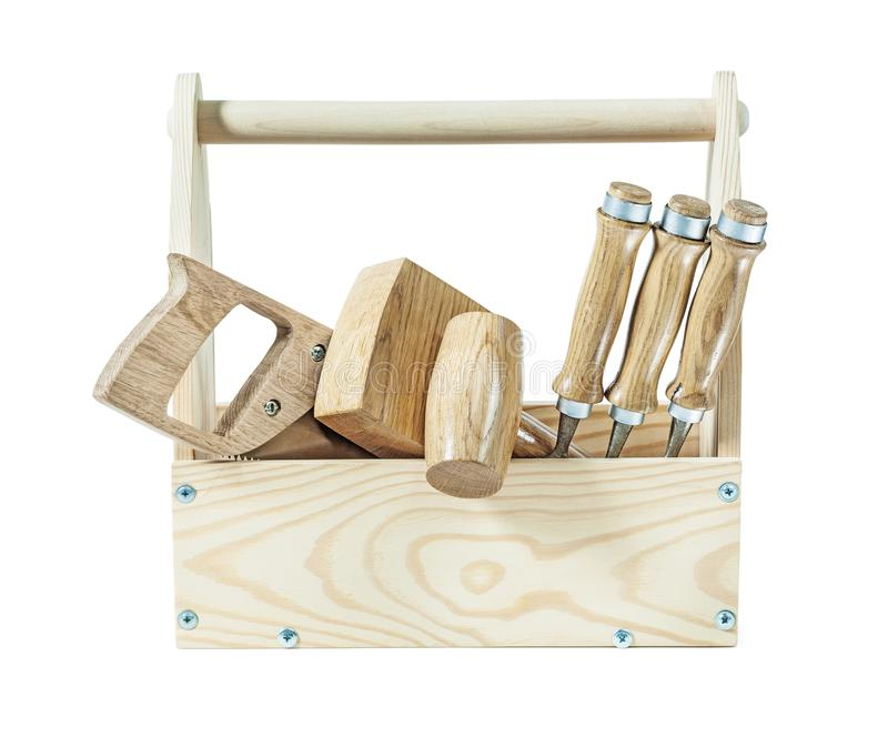 Carpenter tools wooden malet chisels and handsaw in wood toolbox isolated royalty free stock photography