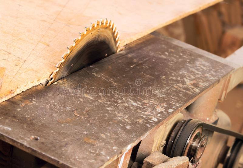 Carpenter tools on wooden table with sawdust. Circular Saw. Cutting a wooden plank.  royalty free stock image