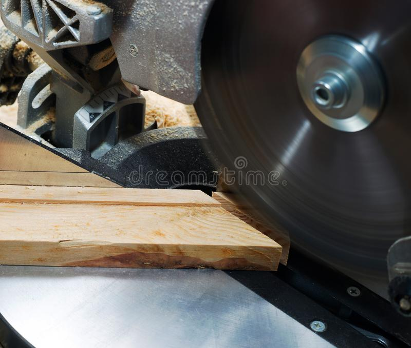 Carpenter tools on wooden table with sawdust. Circular Saw. Cutting a wooden plank.  stock images