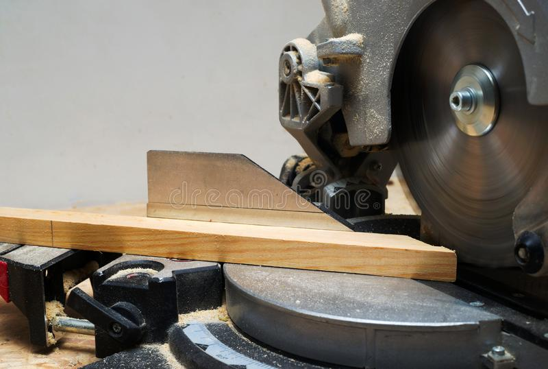 Carpenter tools on wooden table with sawdust. Circular Saw. Cutting a wooden plank stock images
