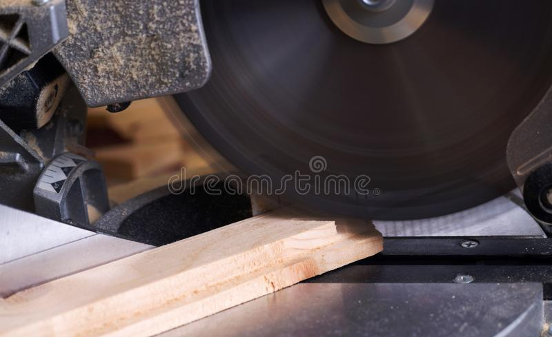Carpenter tools on wooden table with sawdust. Circular Saw. Cutting a wooden plank royalty free stock photography