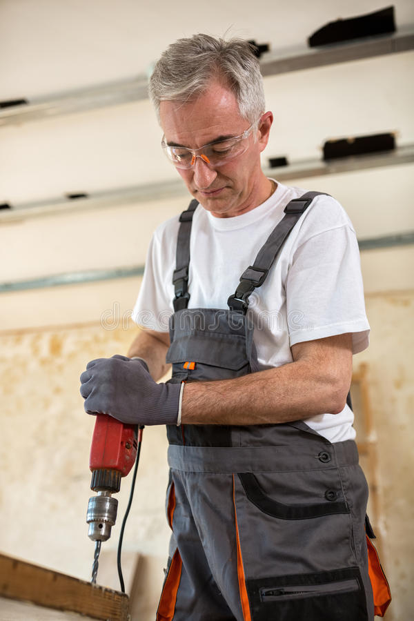 Carpenter used drills in reparation of old doors stock images