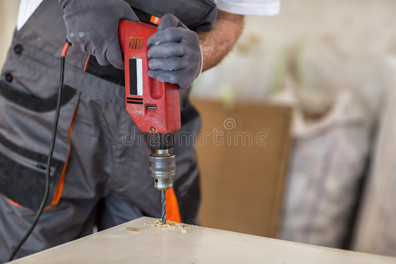 Carpenter used drills in reparation of old doors royalty free stock images