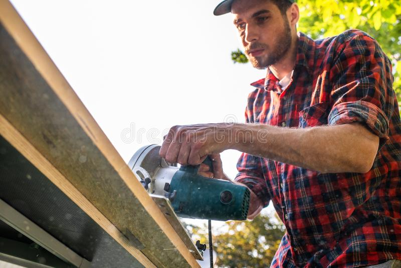 Carpenter using circular saw royalty free stock image