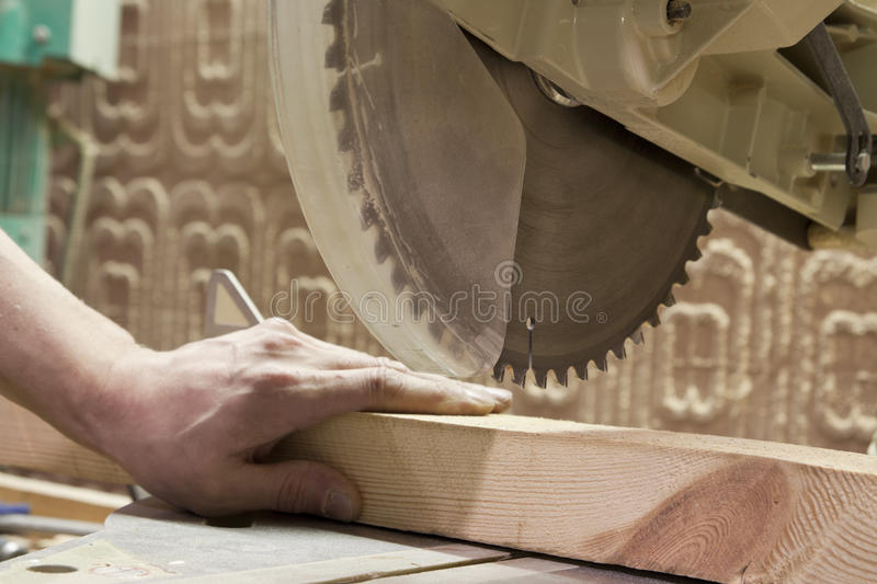 Carpenter using electric saw. Carpentry. Carpenter working in his workshop royalty free stock photos