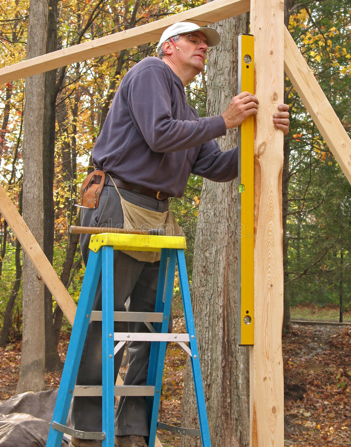 Carpenter using a level royalty free stock photos