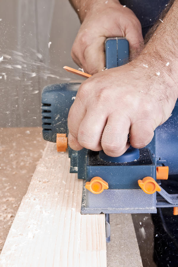 Free Carpenter With Electric Plane Royalty Free Stock Photography - 19304547