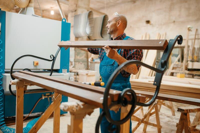 Carpenter, wooden bench manufacturing, joiner job royalty free stock image