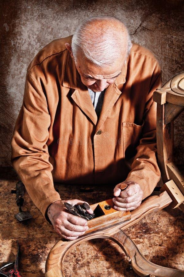 Carpenter at work royalty free stock photo
