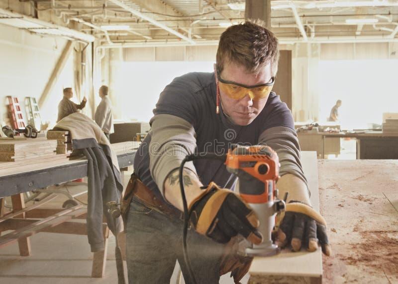 Carpenter. At work at industrial job site stock photo