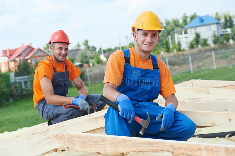 Carpenter Workers On Roof Royalty Free Stock Image