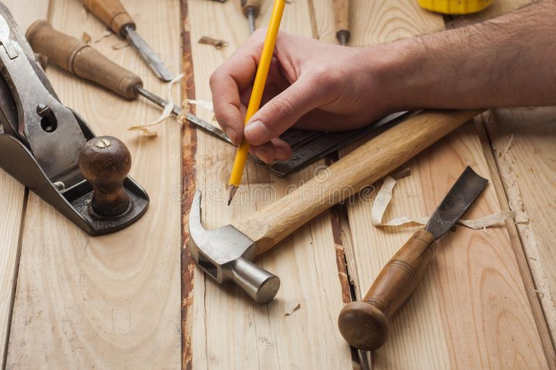 Carpenter working stock images