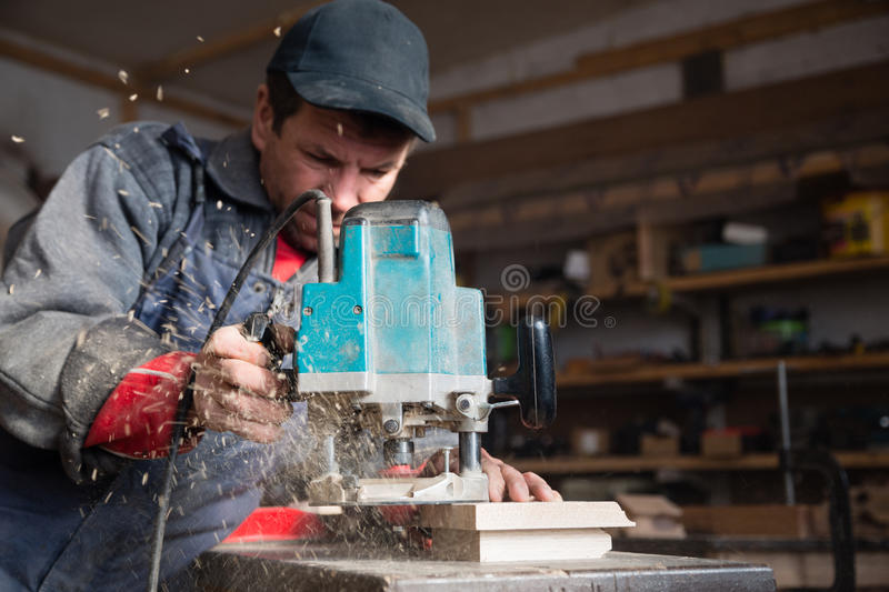 Carpenter working of manual milling machine stock images