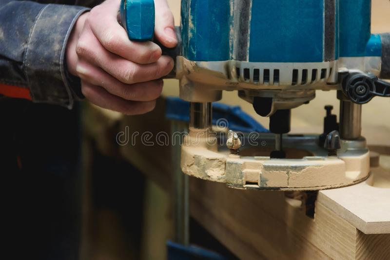 Carpenter Working of Manual Milling Machine in Carpentry Workshop with Copyspace. Industrial Manufactoring Concept. royalty free stock photography