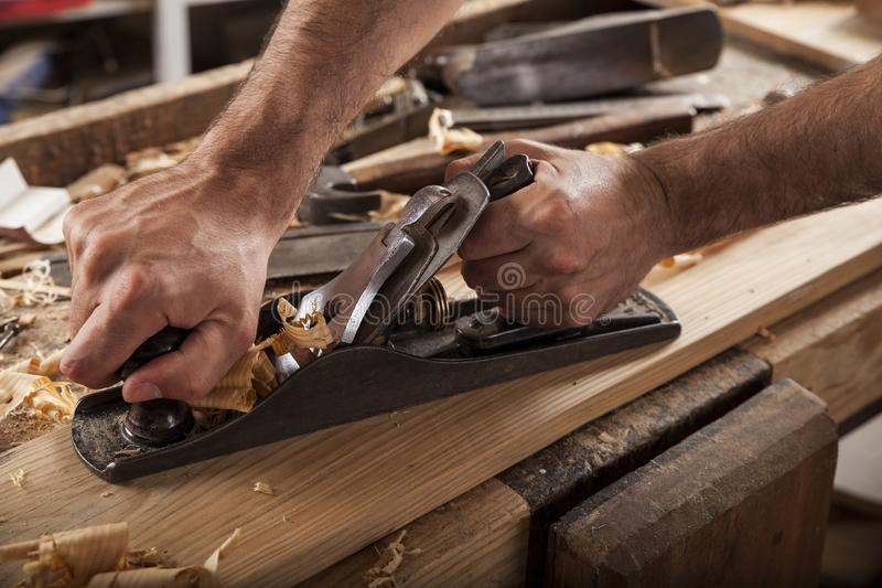 Carpenter working with plane royalty free stock photo