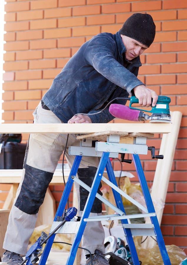 Carpenter Working Polishing Machine royalty free stock photos