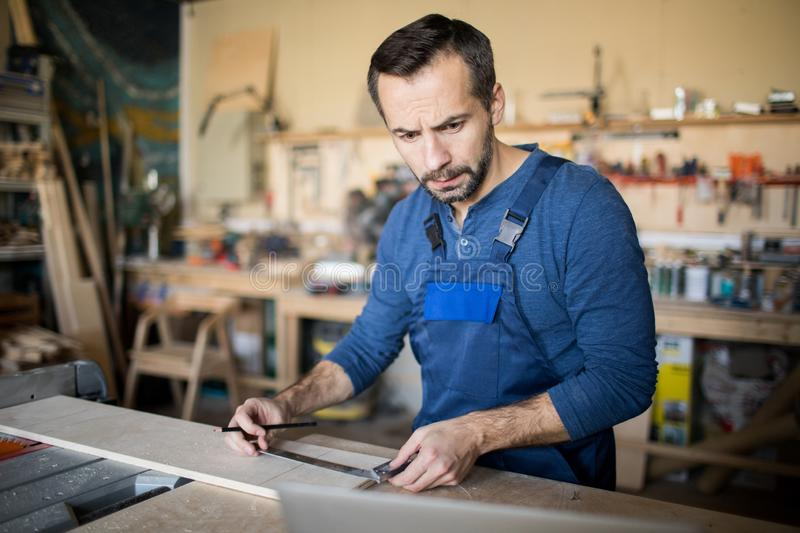 Carpenter Working on Project stock photo
