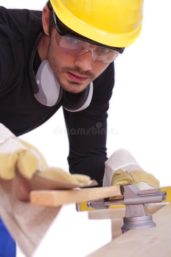 Carpenter working with sandpaper stock photos