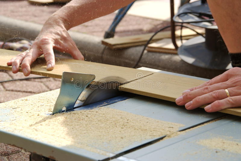 Carpenter working with table saw royalty free stock photo