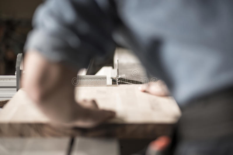 Carpenter working with wood stock image