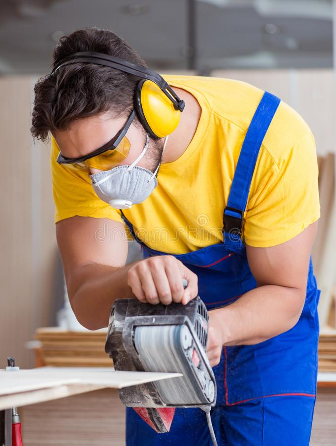 Carpenter working in the workshop royalty free stock photos