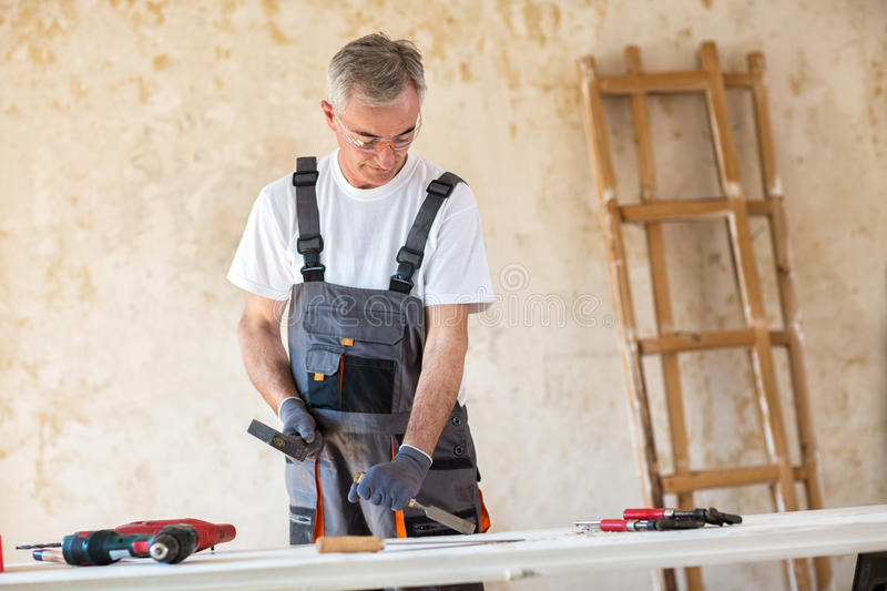 Carpenter is working in a workshop stock photos